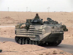 040414-M-9513S-013 14 APR 2004- An Amored Assult Vehicle (AAV) from Echo Company, 2nd Battalion 7th Marines, 1st Marine Division,  moves into the city of Fallujah, Iraq. 1st Marine Division, in support of Operation Iraqi Freedom II, is engaged in Security and Stabilization Operations (SASO) in the Al Anbar Province of Iraq.  (Offical USMC Photograph by LCpl Brandon M. Sorensen) (Released by LtCol Mark A. Olson, IMEF Information Operations Officer)